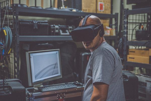developer uses a VR headset to test out a virtual reality app written with C# coding language