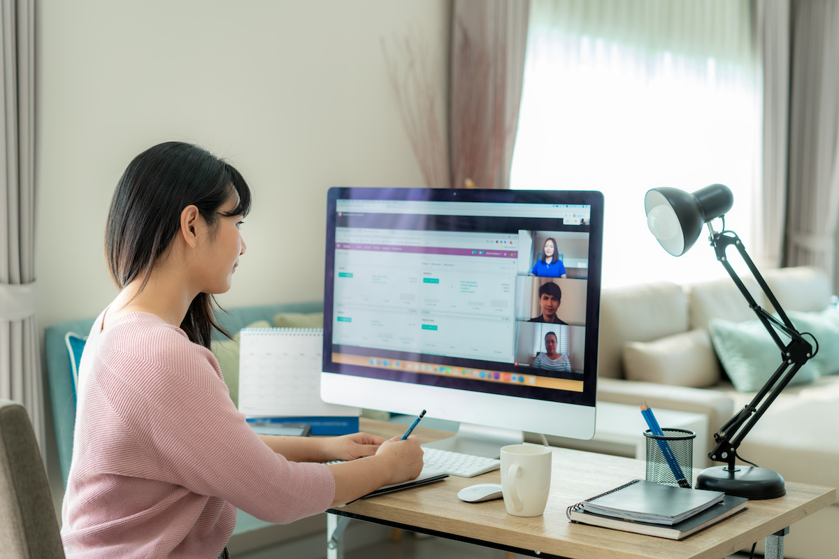 Young woman on group video call