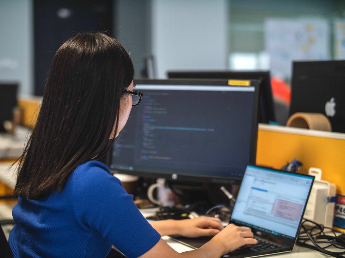 Nonprofit developer using a laptop in an office