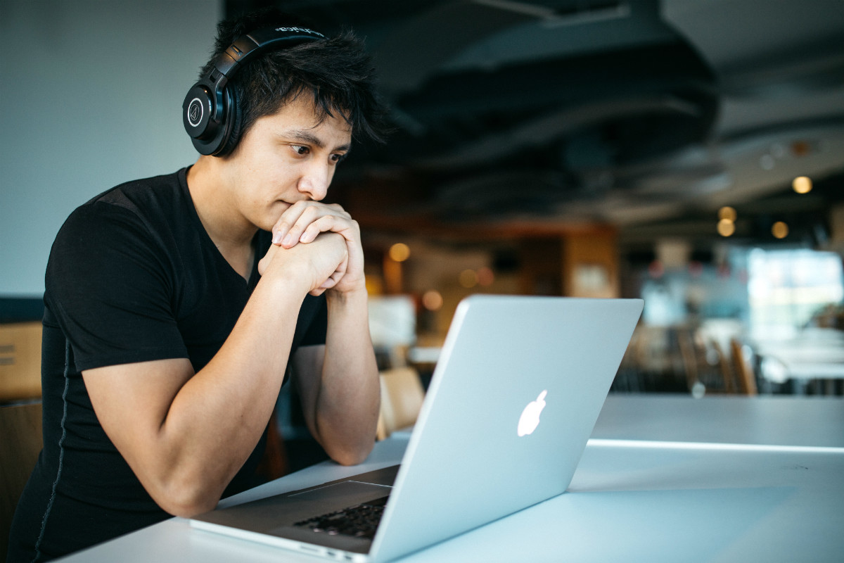 Man at laptop, representing a way one might work in media
