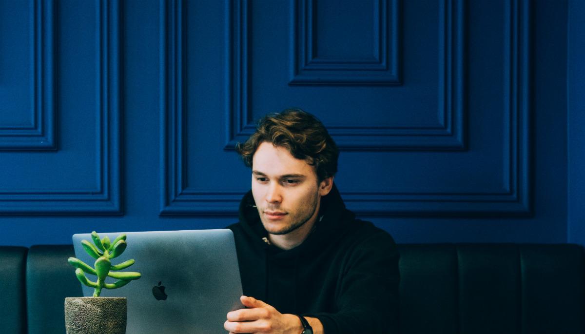 Student using JavaScript tools on laptop