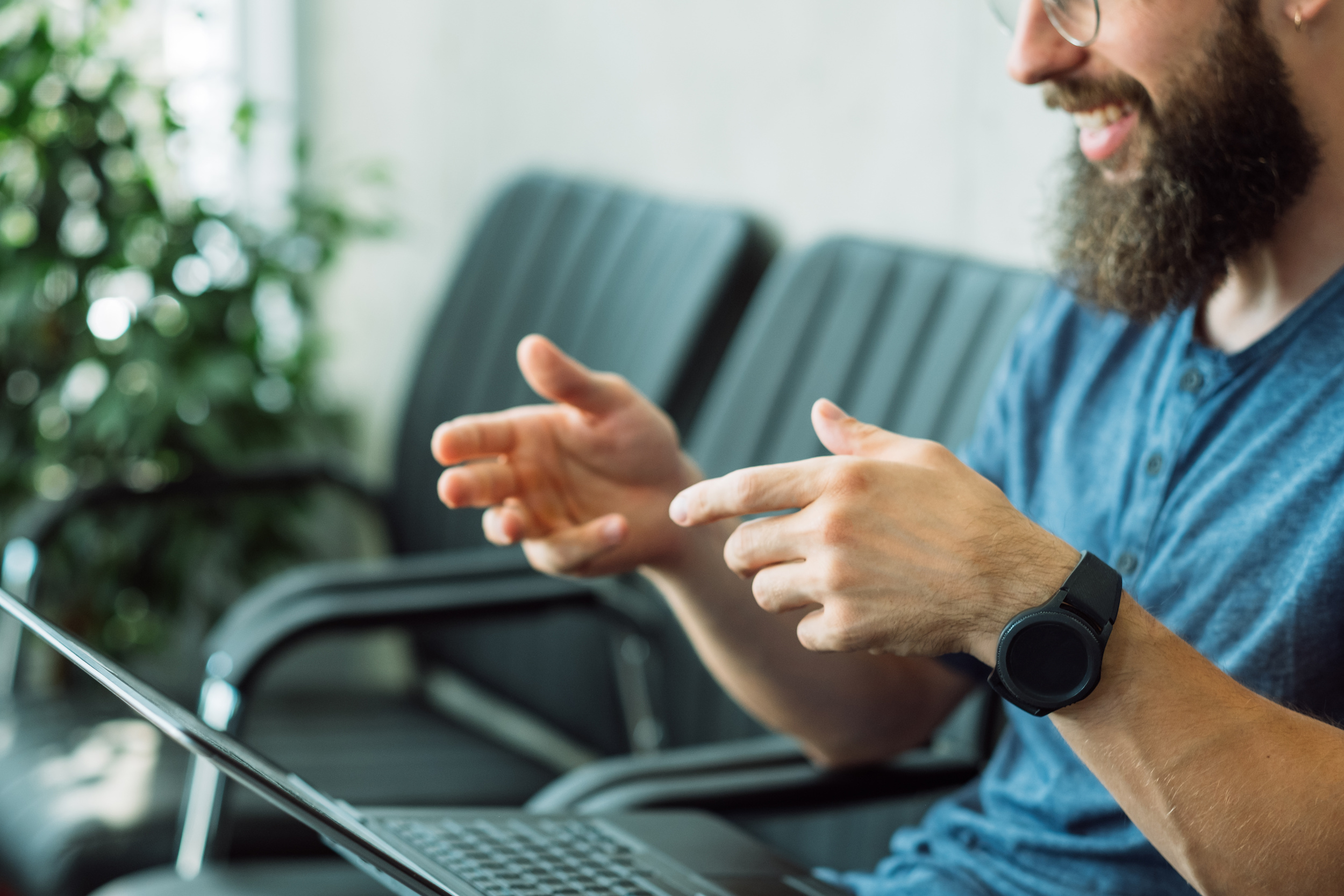 Guy talking to laptop with hands