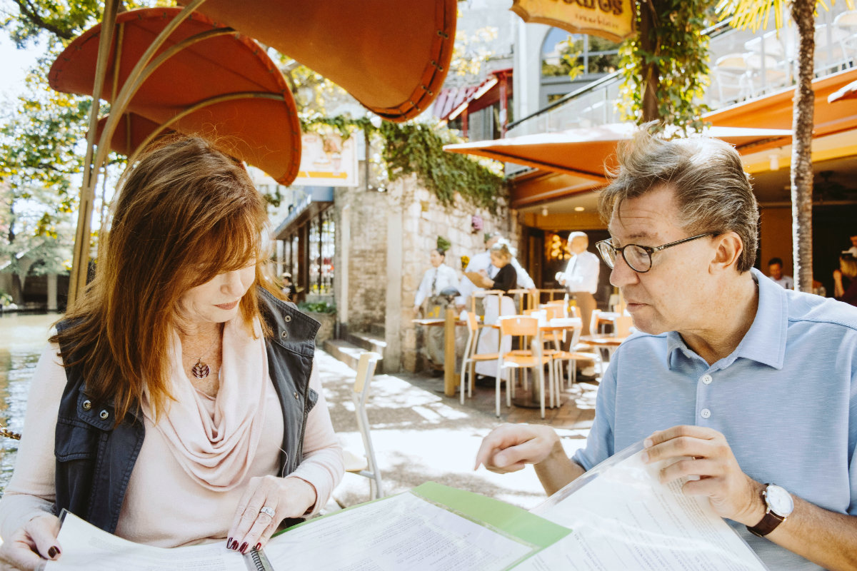 a male and a female have a business meeting outside, representing the gender gap in tech