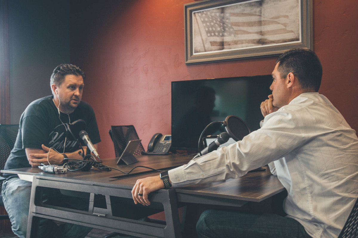 Two men with radio microphones illustrating the idea of Chicago tech podcasts