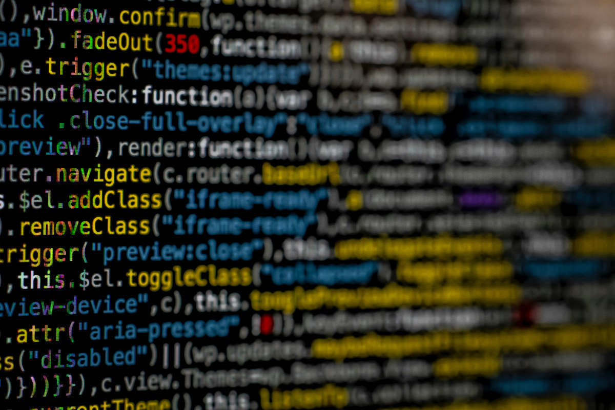 """a dense screen of computer code representing the idea """"what is coding?"""""""