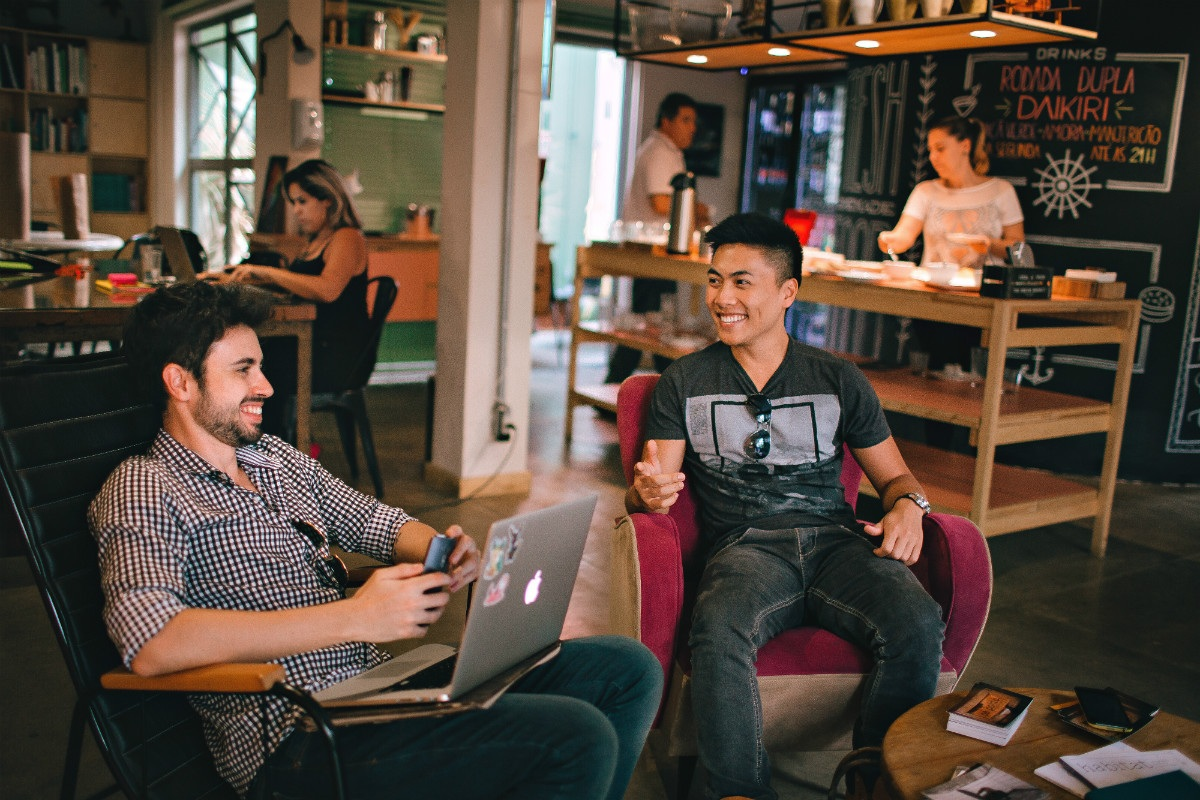 Two coders in a casual workspace representing an answer to the question - Are coding bootcamps worth it?