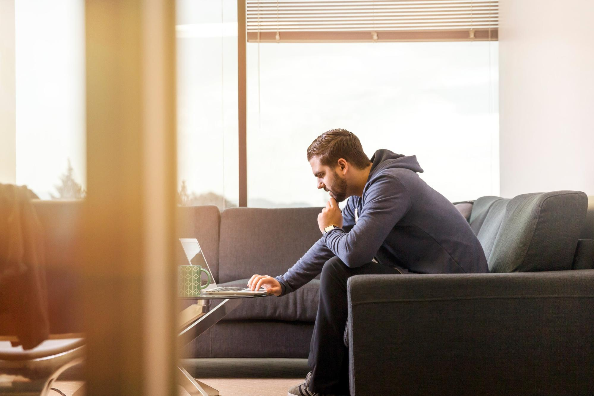 A coder, working from home representing an answer to the question - Are coding bootcamps worth it?