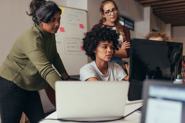 Women learning how to code